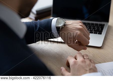 Punctual Businessman Checking Time At Workplace, Consulting Luxury Wristwatch