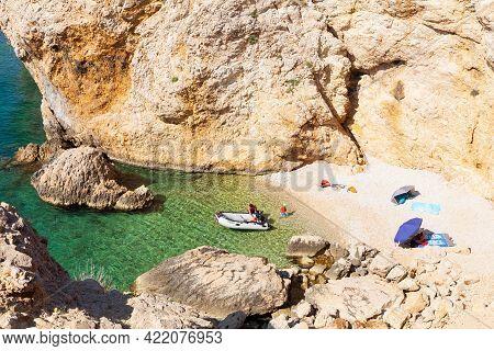 Stara Baska, Croatia - July, 22: Family Relaxing In The Stara Baska Beach During The Summer Season O
