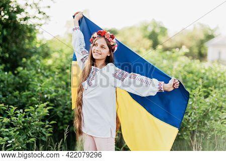 Ukraine's Independence Flag Day. Constitution Day. Ukrainian Child Girl In Embroidered Shirt Vyshyva