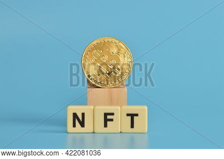 Golden Bitcoin And Alphabet Letters With Text Nft Stands For Non Fungible Tokens.