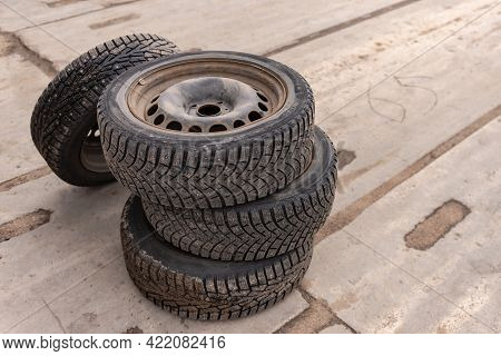 Moscow. Russia. Summer 2020. Winter Wheels From The Car. Old Studded Wheels On Rusty Wheels.