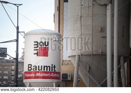 Belgrade, Serbia - May 16, 2021: Baumit Logo On A Concrete Mixer In Front Of A Construction Site. Pa