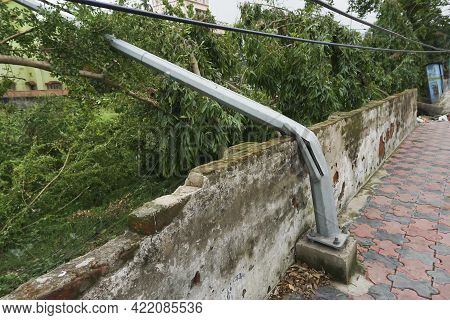 Super Cyclone Amphan ,the Force Destroyed Light Post And A Wall. The Devastation Has Made Many Damag