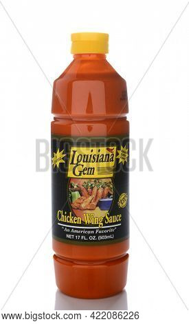 IRVINE, CA - JUNE 14, 2015: A single bottle of Louisiana Gem Chicken Wing Sauce. Packed by Peppers Unlimited in St. Martinville, Louisiana.