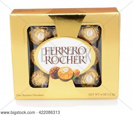 IRVINE, CA - DECEMBER 12, 2014: A box of Ferrero Rocher Chocolates. Since 1982, the candy consists of a whole roasted hazelnut in a thin wafer shell filled with hazelnut cream coated in milk chocolate