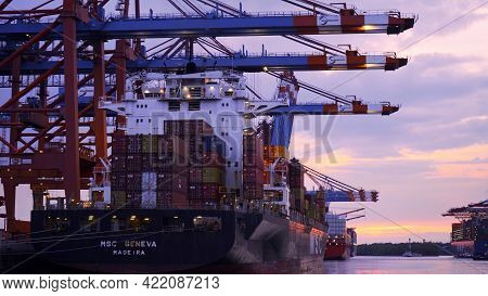 Port Of Hamburg In The Evening In The Back Light - Hamburg, Germany - May 10, 2021
