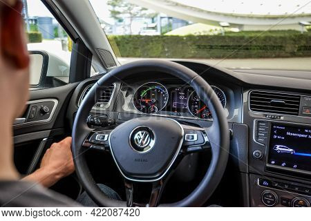 Wolfsburg, Germany - June 19, 2016: Volkswagen Vw E-golf Electric Car On The City Streets, Close Vie