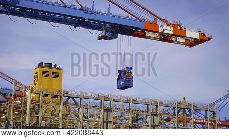 Container Loading And Unloading In The Port Of Hamburg - Hamburg, Germany - May 10, 2021