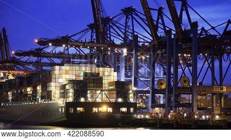 Container Terminal Burchardkai In The Port Of Hamburg By Night - Hamburg, Germany - May 10, 2021