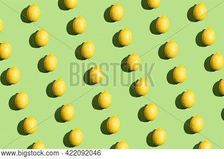 Colorful Pop Art Style Repetitive Pattern Made Of Lemons With Hard Shadow On Green Background