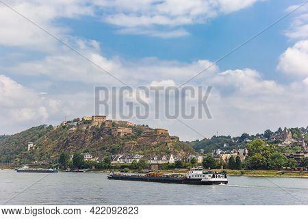 Cargo Ship Passing The Ehrenbreitstein Fortress In Koblenz, Germany
