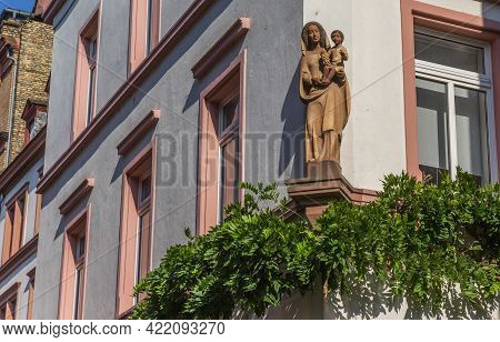 Statue Of Maria And Baby Jesus On An Old Building In Mainz, Germany