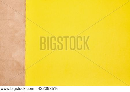 Eco-friendly Disposable Made Of Paper. Brown Craft Paper Bag On Yellow Background From Natural Mater