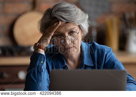 Mature Woman Feels Confused Experiencing Difficulties With Laptop Usage