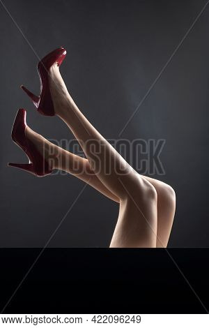 Shoes Advetising. Legs In Red Heels. Fashion Shoes Style. Girl Sexy Slim Feet.