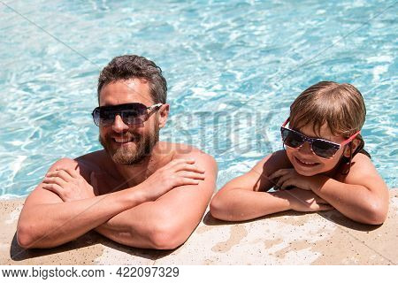 Father And Son In Pool. Pool Party. Boy With Dad Playing In Swimming Pool. Active Lifestyle Concept.