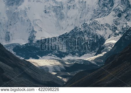 Awesome Mountain Landscape With Glacier In Golden Sunshine On Background Of Giant Snow-covered Mount