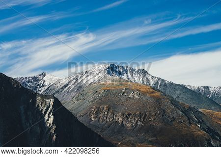 Colorful Alpine Landscape With Great Mountain In Autumn Colors With Snow On Peak In Sunshine Under C