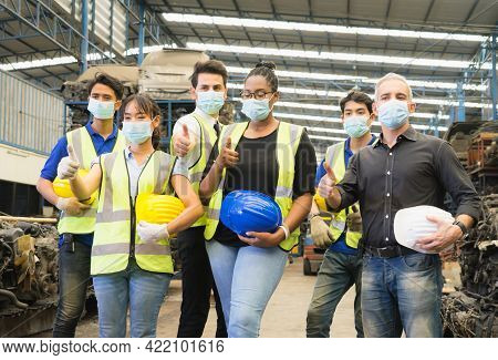 Men And Woman Work Together, Show Teamwork By Giving Thumbs Up And Wear Facemask. Caucasian Engineer