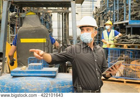 Men Work Together, Wear Safety Facemask, Use Tablet, Look Right Side With Pointing. Caucasian Engine