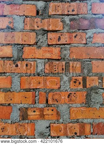 Background Texture Of Dried Clay Bricks Wall. Image Contain Grains Of Cement And Clay.