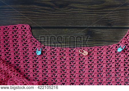 Crocheting With Pink Cotton Threads On A Dark Wooden Background. Crochet Process With Pink Cotton Ya
