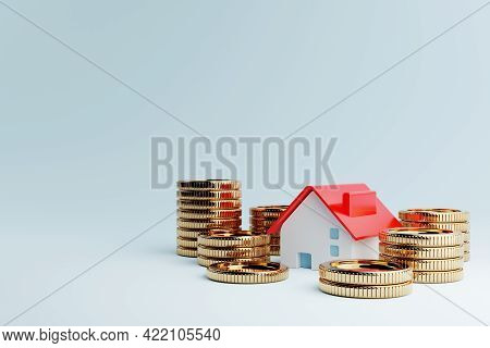 Real Estate House And Golden Coins On Blue Background. Business Mortgage Investment And Financial Lo