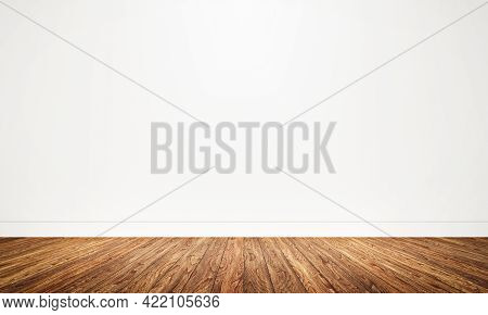 Empty Room With Wooden Floor Background. Table Top For Advertising And Copy Space. Architecture And