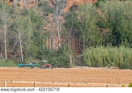 Red Stone Hills, South Africa - April 6, 2021: A Tractor, With Trailer, At Red Stone Hills In The We