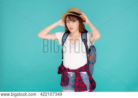 Beautiful Young Asian Woman Upset And Worry Travel Summer Trip In Abroad Isolated On Blue Background