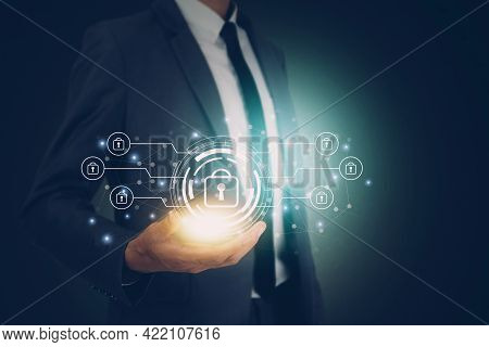 Hand Of Businessman Holding Virtual Lock Icon While Cyber Security, Access Data And Privacy With Pro
