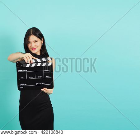 Clapper Board Or Movie Clapperboard In Asian Woman Hand With Black Color.it Use In Video Production