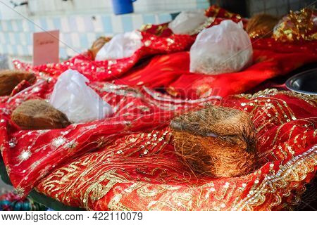 A Set Of Offering To God In India Temples. In India It Is A Custom To Offer Coconut And Red Cloth Al