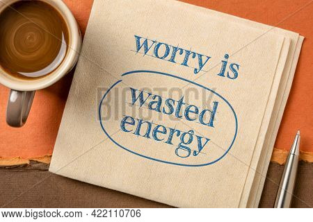 worry is wasted energy - inspirational handwriting on a napkin with a cup of coffee, positive mindset and optimism concept