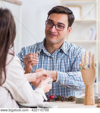 Woman visiting jeweler for jewelery evaluation