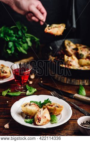 Baked Jumbo Shells Pasta Stuffed With Ground Beef, Spinach And Cheese On White Plate
