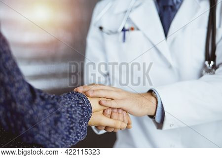 Friendly Doctor Reassuring Female Patient, Close-up. Medical Ethics And Trust Concept