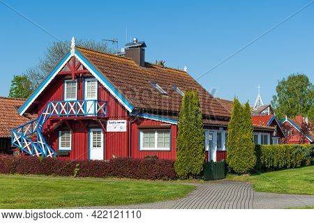 Nida, Lithuania - May 23 2021: Beautiful Old Lithuanian Traditional Wooden Houses Of The Curonian Sp