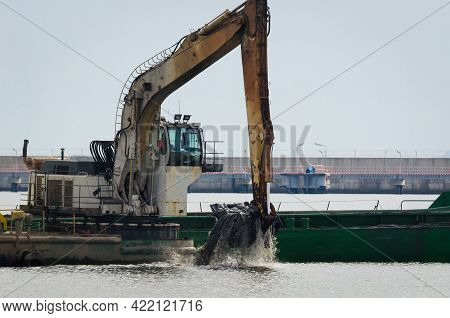 Construction Work In A Seaport - Excavator On A Floating Work Platform