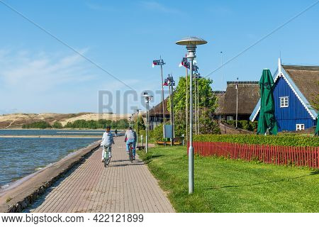 Nida, Lithuania - May 23 2021: Fisherman's Houses. Beautiful Old Lithuanian Traditional Wooden Blue