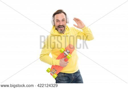 Happy Man Skateboarder Listen Music In Headphones Hold Skateboard Isolated On White, Having Fun.
