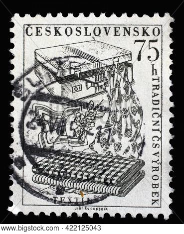 ZAGREB, CROATIA - SEPTEMBER 18, 2014: Stamp printed in Czechoslovakia shows Textiles from the series Traditional products of the Czechoslovakia, circa 1956