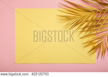 Yellow Card Copy Space For Text In Frame Made Of Golden Palm Leaf. Tropical Palm Leave On Pink Backg
