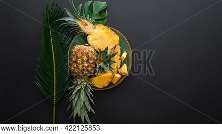 Sliced Pineapple On Plate With Tropical Palm Leaves. Bromelain Whole Pineapple Summer Fruit Halves P