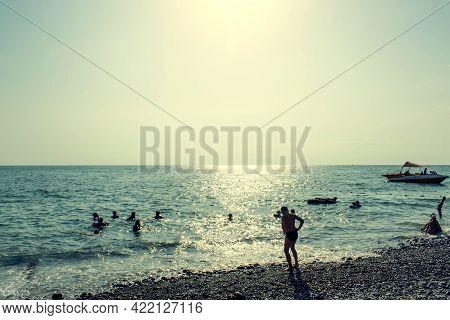 Sochi, Russia - 27 Juny, 2018: Holidaymakers On A Pebble Beach Near The Sea In Loo, Sochi.