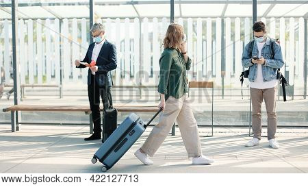 People Standing On Train Station Or Bus Stop Outdoors Travelling During Coronavirus Pandemic. Man Te