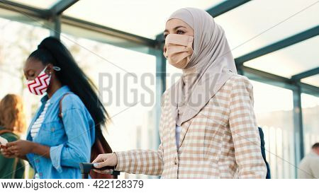 Portrait Of Mixed-race Women With Suitcases In Masks Walking Outdoors On Street. Different People Tr
