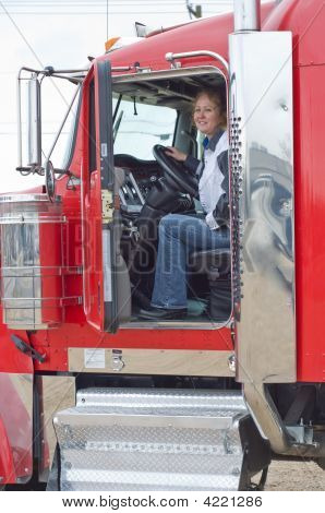 Interior View Of Big Rig With Woman Driver