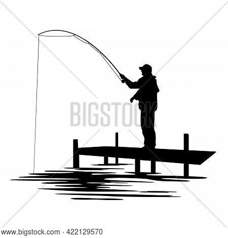 Black Silhouette Of A Fisherman In A Cap Holding A Fishing Rod And Standing On A Bridge. Fishing On