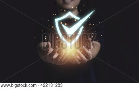 Businessman Holding Cyber Security And Information Technology Network System Protection.
